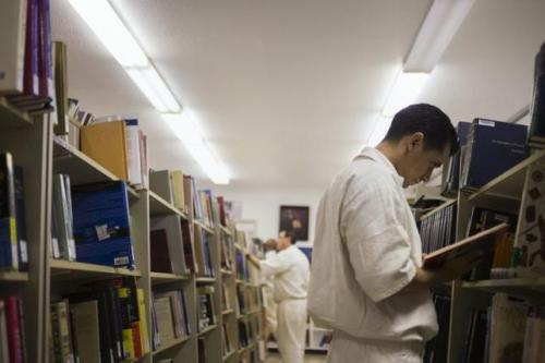 Offenders search for books at a library inside the Southwestern Baptist Theological Seminary located in the Darrington Unit of the Texas Department of Criminal Justice men's prison in Rosharon, Texas